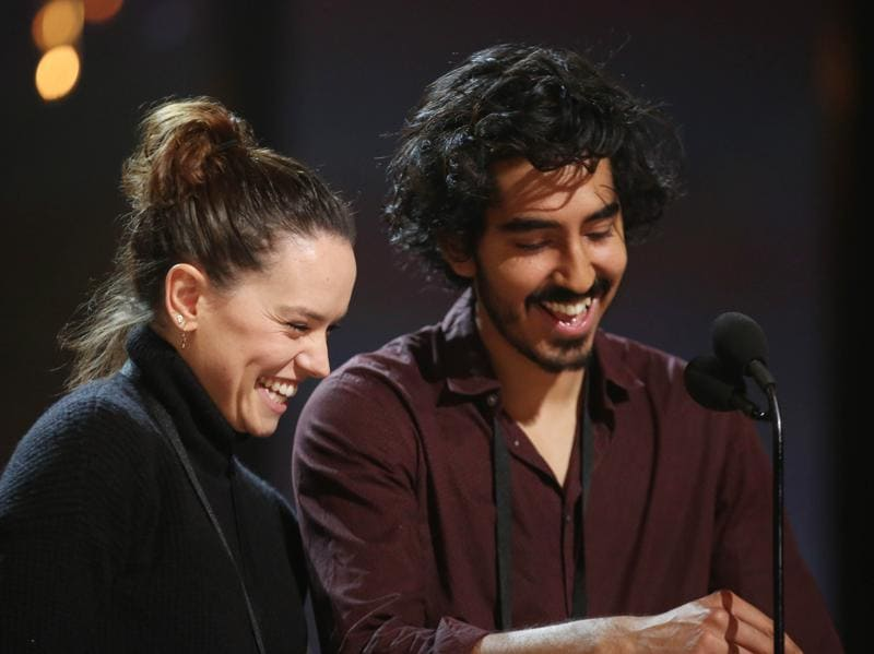 Daisy Ridley, left, and Dev Patel.  While the men rehearsing on Saturday wore sneakers or other casual shoes, most of the women tried out the towering high heels they plan to wear during the show. (Matt Sayles/Invision/AP)