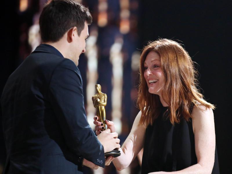 Julianne Moore takes a fake trophy. (Matt Sayles/Invision/AP)