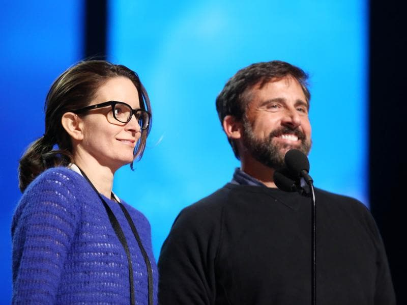 "Tina Fey, left, and Steve Carell. Fey asked Steve Carell about their ""Saturday Night Live"" colleague during rehearsals. Sudeikis is attending the show with fiancée Olivia Wilde, who is a presenter. ""We're in the second row,"" Carell pointed out. ""Not too bad,"" Fey replied. (Matt Sayles/Invision/AP)"