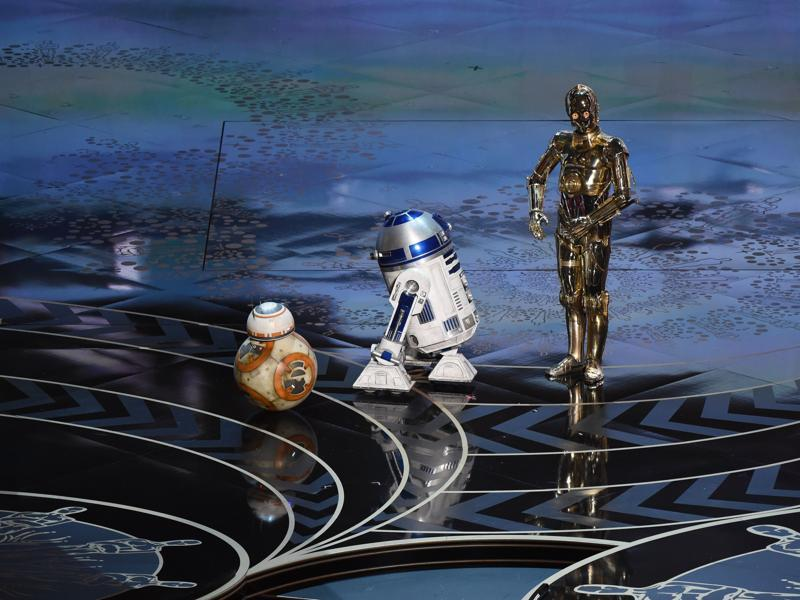 Star Wars characters C-3PO, R2D2 and BB-8 arrive on stage at the 88th Oscars, getting the loudest cheer of the night. (AFP)