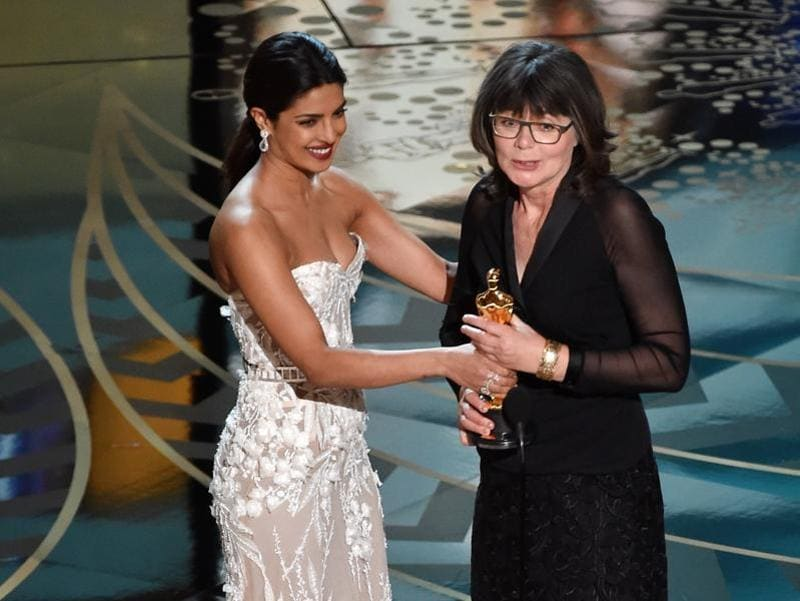 Priyanka Chopra presents Margaret Sixel and Oscar for Best Editing. Sixel edited Mad Max: Fury Road.  (AFP)