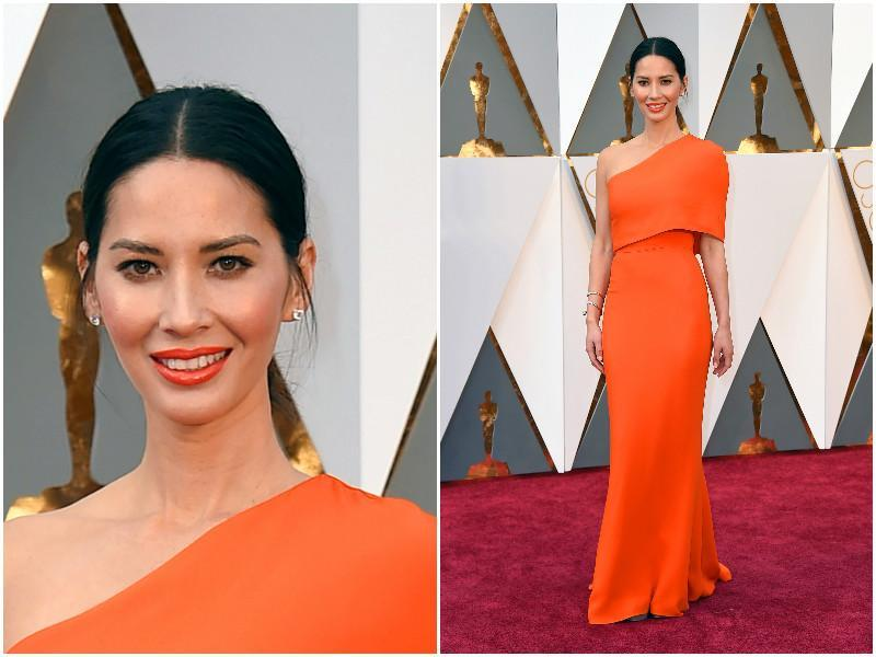 Olivia Munn is shining bright like the sun in this orange dress but whatever has she done to her face? We had to take a second look. (AP)