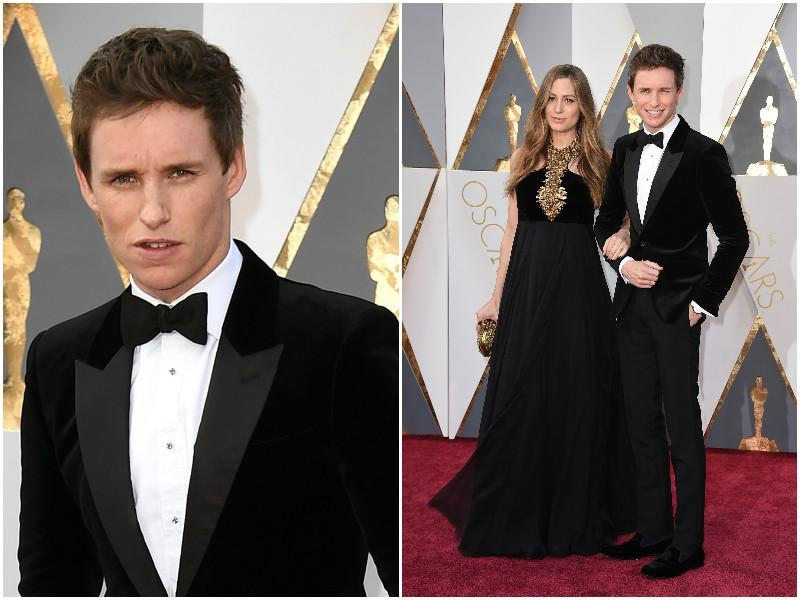 Eddie Redmayne with pregnant wife Hannah. Redmayne says that the velvet suit is making him sweat like anything. (AP)