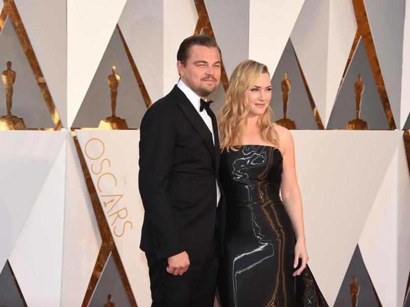 Leonardo DiCaprio and Kate Winslet arrive together. Dunno about Leo but Kate Winslet looks too smitten by spandex. (AP)