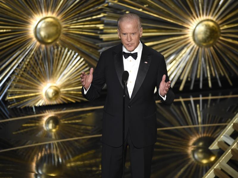 Vice President Joe Biden introduces a performance by Lady Gaga at the Oscars, drawing the first standing ovation of the day as he called for a change of culture.  (AP)