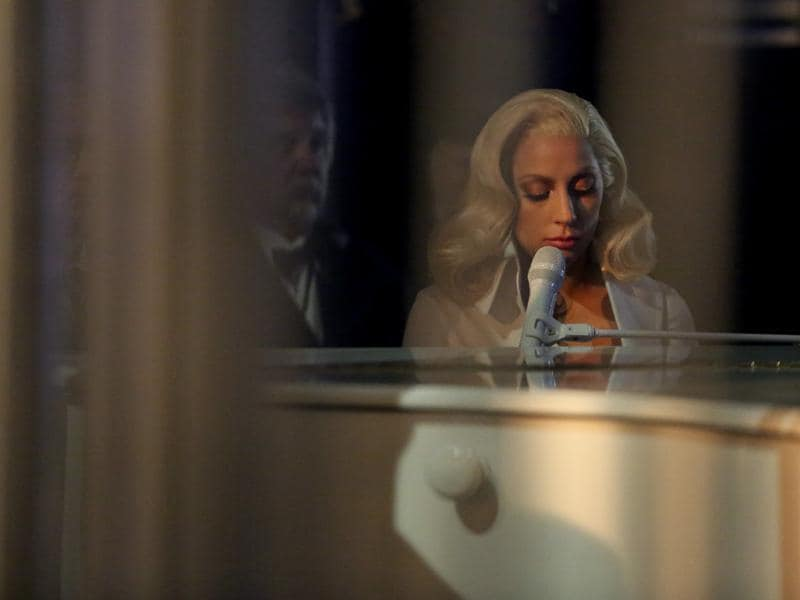 Lady Gaga is seen from backstage as she performs her nominated song Til It Happens To You at the Oscars on Sunday, getting a standing ovation for her performance. (AP)