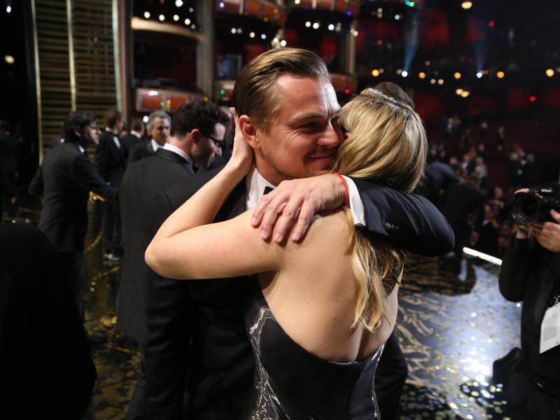 Leonardo DiCaprio, winner of the Oscar for best actor in a leading role for The Revenant embraces his Titanic co-star Kate Winslet backstage at the Dolby Theatre.  (AP)