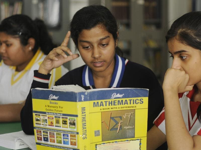 With CBSE exams scheduled to begin from March 1, Class 12 students are engaged in getting their doubts cleared from their teachers and friends at the Study Hall School in Lucknow on Saturday.  (Deepak Gupta/ HT photo)
