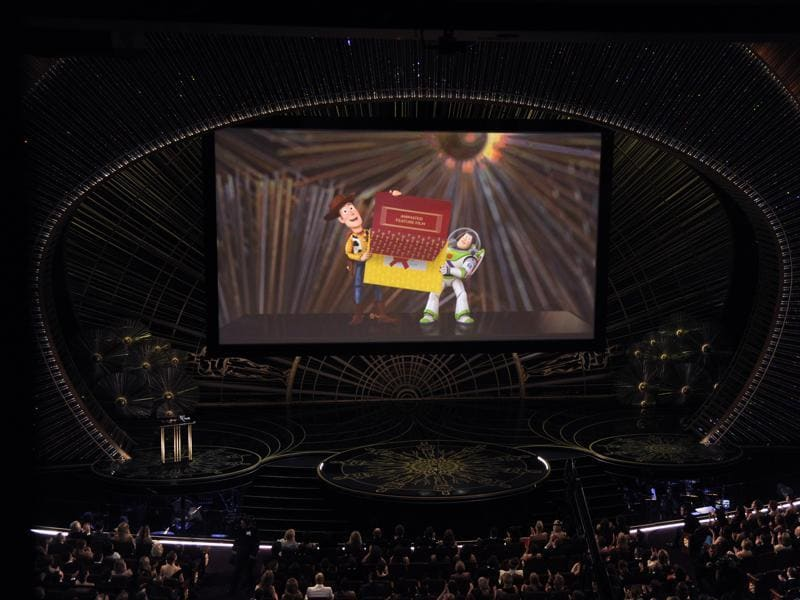 Woody and Buzz Lightyear from Toy Story appear on screen presenting the award for best animated feature film at the Oscars. The Pixar film Inside Out bagged the award. (AP)