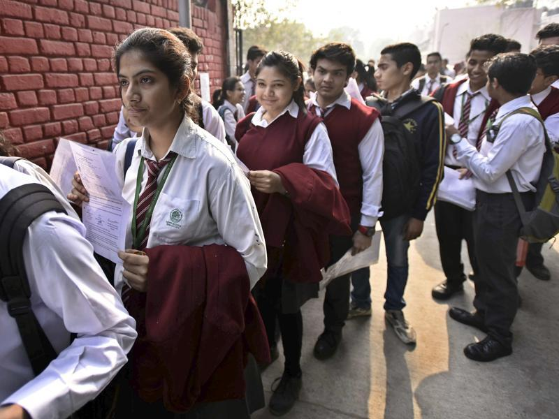 Class 12 students queue up at their exam centre before the CBSE Board exams at St. Thomas' School in New Delhi. (Arun Sharma/HT photo)