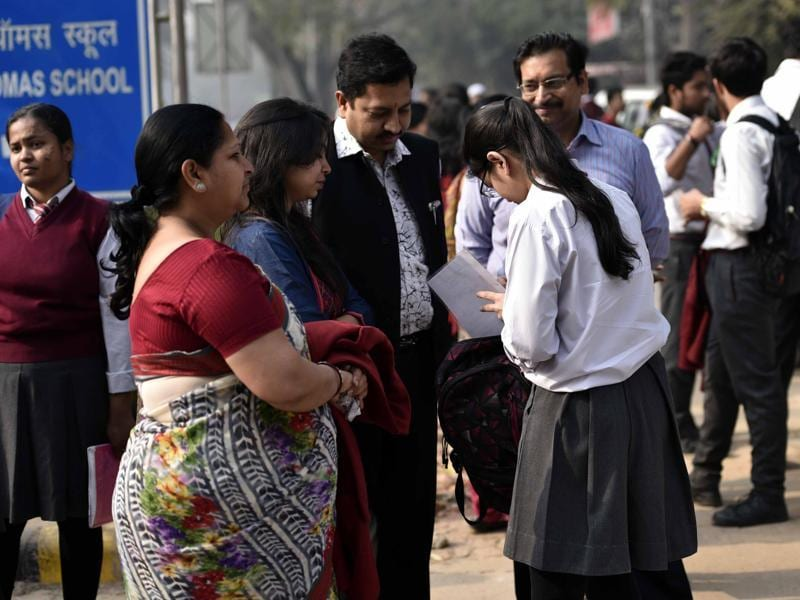 Students and their nervous parents before going to the exam hall at St Thomas' School,  Gole Market,  New Delhi ahead of the Board exams. (Arun Sharma/HT photo)