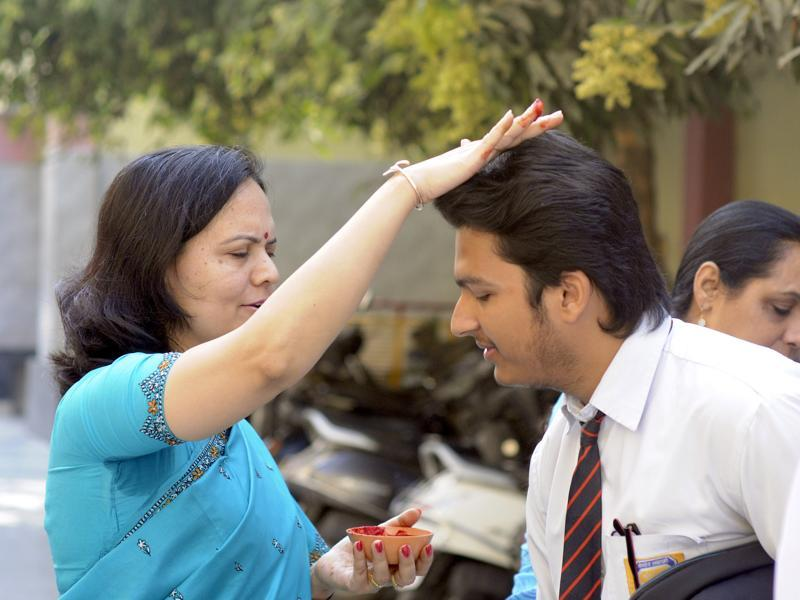 A teacher gives her blessings to a student ahead of the Class 12 CBSE exams in Lucknow. (Deepak Gupta/HT photo)