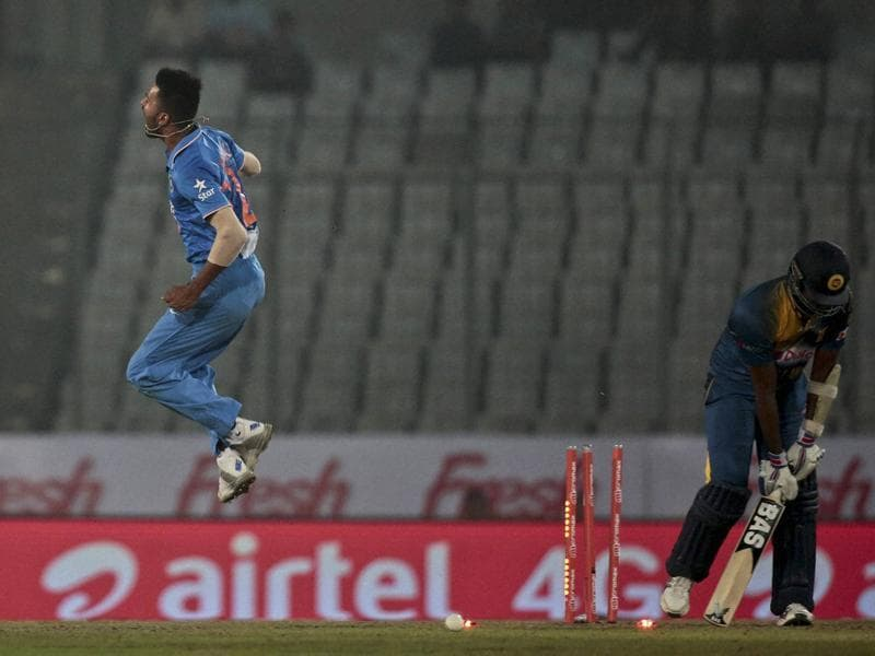 India's Hardik Pandya, left, reacts after claiming the wicket of Sri Lanka's captain Angelo Mathews. (AP Photo)