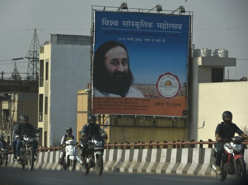 "A festival hoarding on the bank of the Yamuna.The Art Of Living foundation, on its part, has said that they have started work ""only upon the grant of permission from the authorities/DDA"" and are using eco-friendly material like wood, mud, cloth for the constructions. (Saumya Khandelwal/HT Photo)"