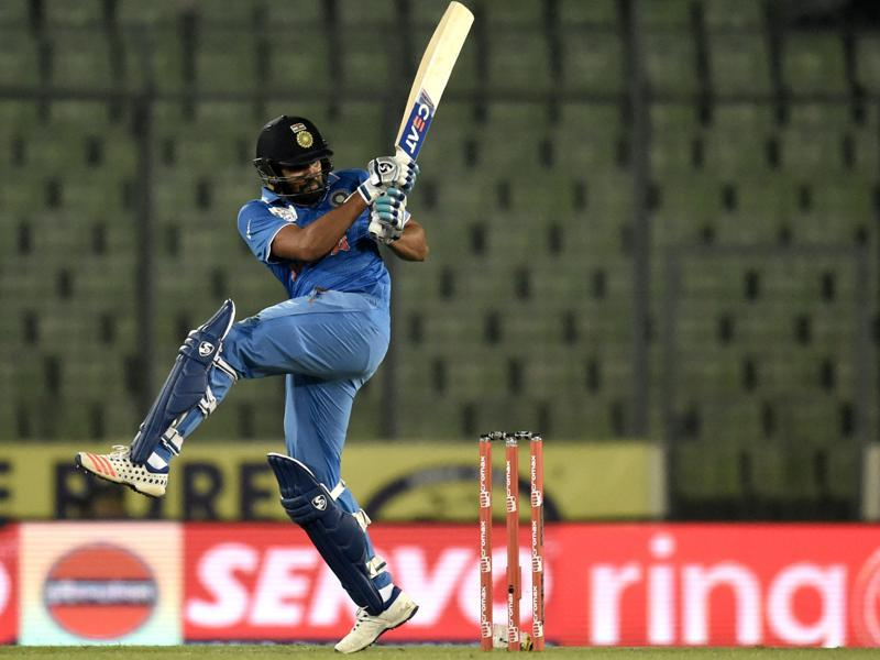 Rohit Sharma plays a shot during the Asia Cup T20 cricket tournament match between United Arab Emirates and India at The Sher-e-Bangla National Cricket Stadium. (AFP Photo)