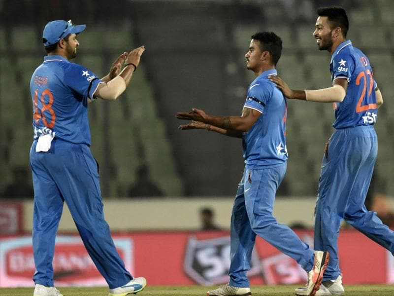 Indian cricketer Suresh Raina  and Hardik Pandya  congratulate teammate Pawan Negi. (AFP Photo)