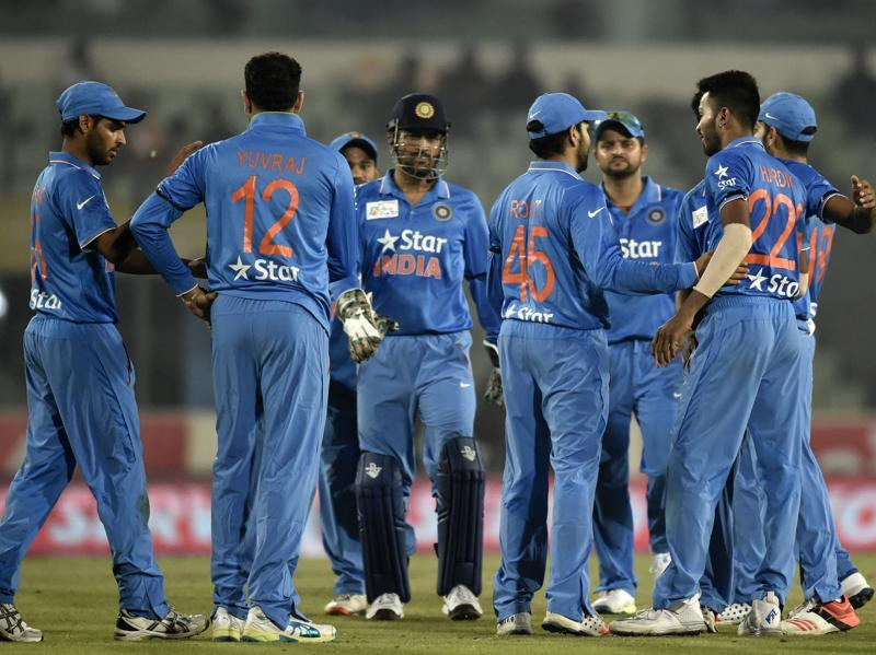 Indian cricketers celebrate after the dismissal of unseen United Arab Emirates batsman Muhammad Kaleem. (AFP Photo)