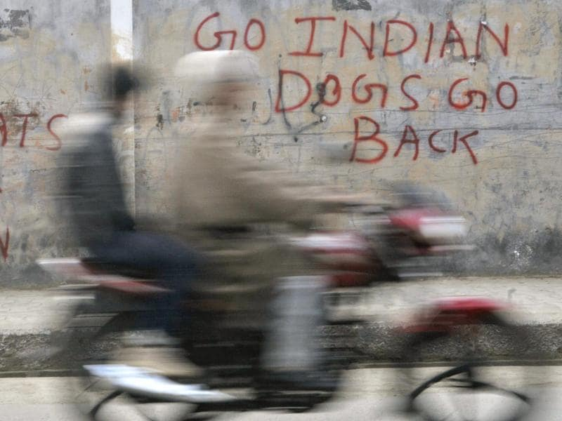 Though the alleged anti-national sloganeering in JNU has snowballed into a big national debate, walls and shutters of shops in Srinagar can be seen delivering many anti-India slogans, some of them even more 'provocative' ones. (Waseem Andrabi//HT Photo)