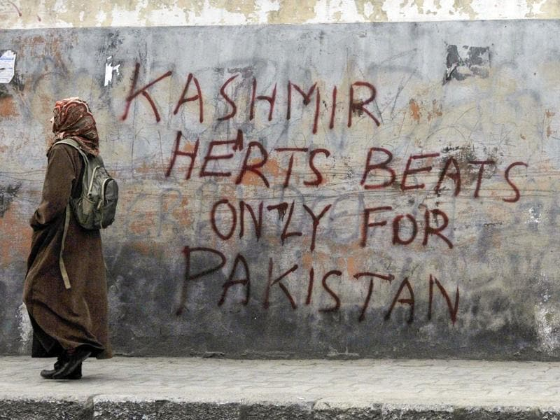 Ahead of the India-Pakistan T20 match at Mirpur last Sunday, a set of pro-Pakistani graffiti was spotted on a stretch of wall in Downtown Srinagar.  (Waseem Andrabi//HT Photo)