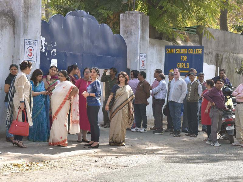 Parents waiting for the board exam to get over at Saint Soldier's School, Jaipur. (Prabhakar Sharma/Ht photo)