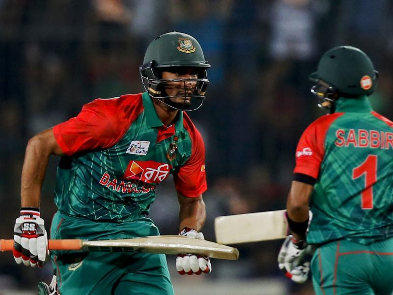 Bangladesh's Mahmudullah, left, and his teammate Sabbir Rahman run between the wickets. (AP Photo)