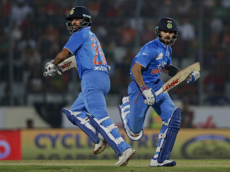 India's Virat Kohli and Shikhar Dhawan run between the wickets during the Asia Cup Twenty20 international cricket final match. (AP Photo)