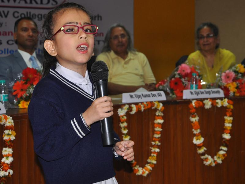 A school student during a function to celebrate  International Women's Day. (HT Photo )
