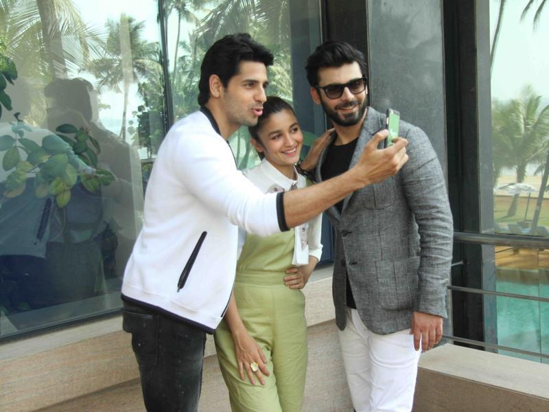 Actors Sidharth Malhotra, Alia Bhatt and Fawad Khan take a selfie during the media interaction of film Kapoor & Sons in Mumbai. (IANS)