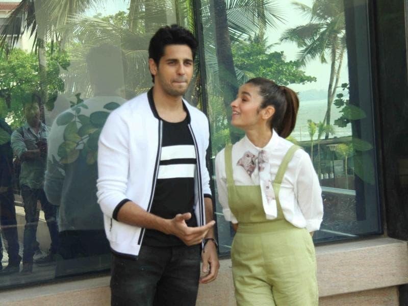 Actors Sidharth Malhotra and Alia Bhatt  share a light moment during during the media interaction of film Kapoor & Sons. (IANS)
