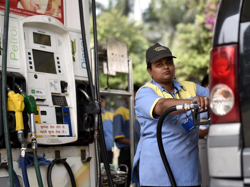 Saima, a 30-year-old employee of a Petrol pump continues with her daily schedule. (Arun Sharma/HT Photo)
