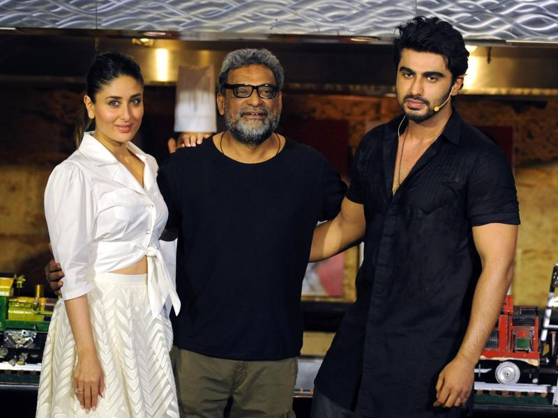 Kareena Kapoor (L) poses with actor Arjun Kapoor (R) and director R Balki (C) during the promotion of the forthcoming Hindi film Ki & Ka. (AFP)
