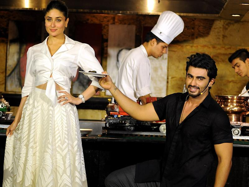 ... while Arjun Kapoor was seen flipping the perfect omelette, albeit with a little help from the chef in the background. (AFP)