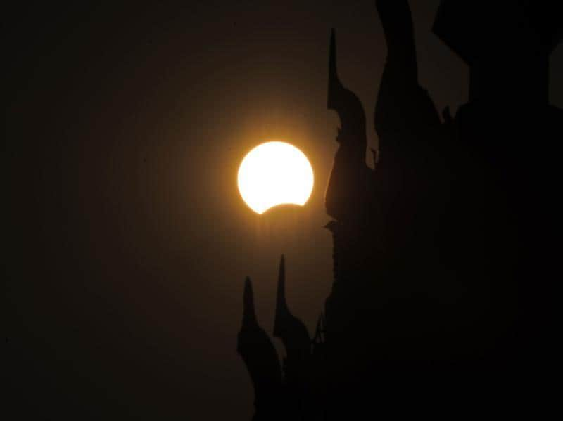 This picture shows the moon passing in front of the sun during the partial solar eclipse in Naypyidaw on Wednesday morning. A total solar eclipse swept across the vast Indonesian archipelago on March 9, witnessed by tens of thousands of sky gazers and marked by parties, Muslim prayers and tribal rituals. Partial eclipses were also visible over other parts of Asia and Australia. / AFP / YE AUNG THU (AFP)