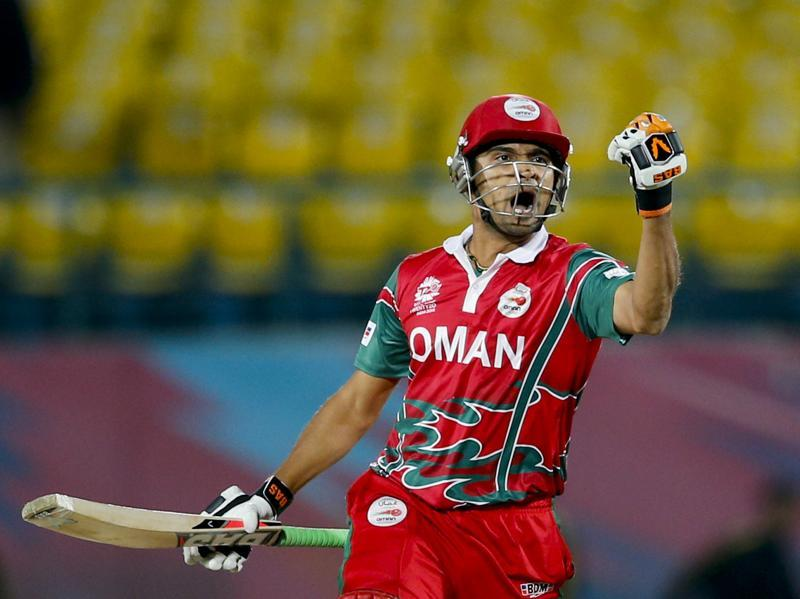 Oman's Ajay Lalcheta celebrates after they won the ICC World T20 qualifier match against Ireland at the Himachal Pradesh Cricket Association (HPCA) stadium in Dharmsala on March 9, 2016. Oman won by two wickets. (AP)