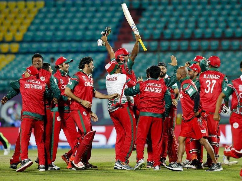 Oman players lift their match-winning batsmen in the air in celebration. (AP)