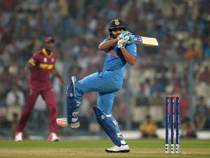 Rohit Sharma plays a shot during a warm-up match between India and West Indies. (AFP Photo)