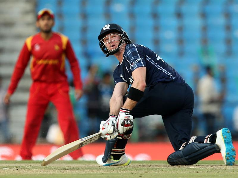 Scotland's Richie Berrington watches the ball after playing a shot during the World T20. (AFP Photo)