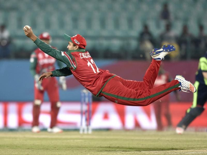 Zeeshaan Maqsood of Oman takes a catch to dismiss PR Stirling. (Gurpreet Singh/HT Photo)