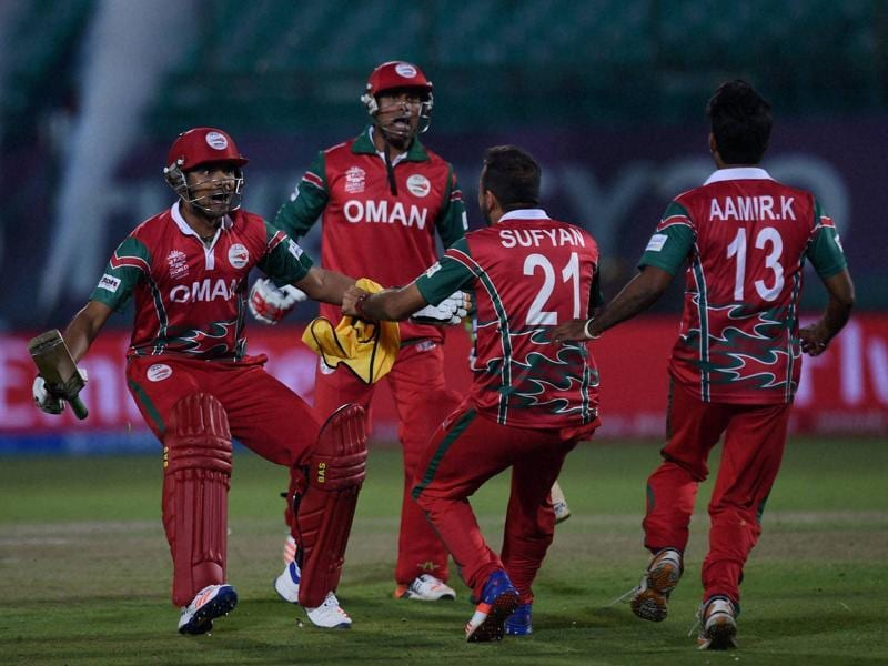 Oman batsmen M Ansari and AV Lalcheta celebrate with teammates after victory. (PTI)