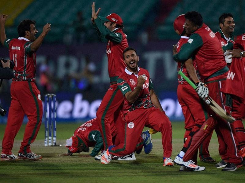 Oman players are overjoyed after their win, their first in the World T20 on their debut in the tournament. (PTI)