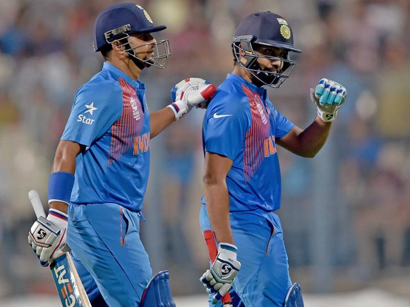 India's Rohit Sharma being greeted by Suresh Raina after his dismissal. (PTI Photo)