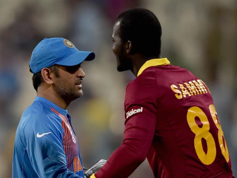 Indian skipper M S Dhoni and Darren Sammy captain of West Indies greet each other. (PTI Photo)