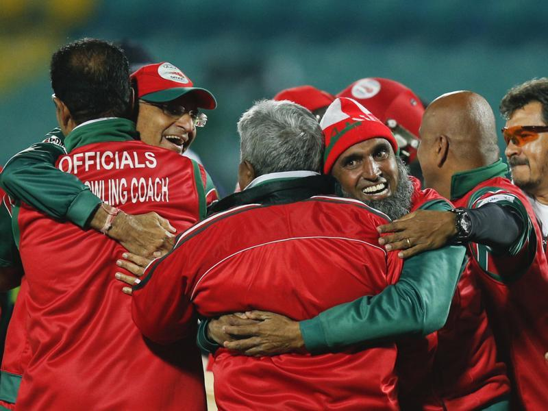 Oman's team officials join in the celebrations. (AP)