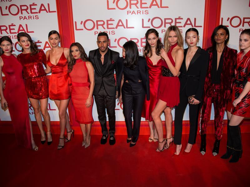 F1 star Lewis Hamilton (fifth from left), and actresses Eva Langoria (fourth from left) and Leila Bekhti (centre) pose with models--(from left) Bianca Balti, Isabeli Fontana, Irina Shayk, Luma Grothe, Natasha Poly, Xiao Wen Ju, Liya Kebede and Barbara Palvin. (AP)