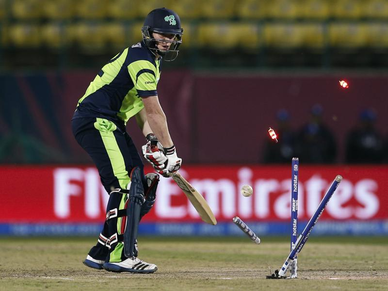 Ireland's Kevin O'Brien is bowled out by Oman's Munis Ansari. (AP)