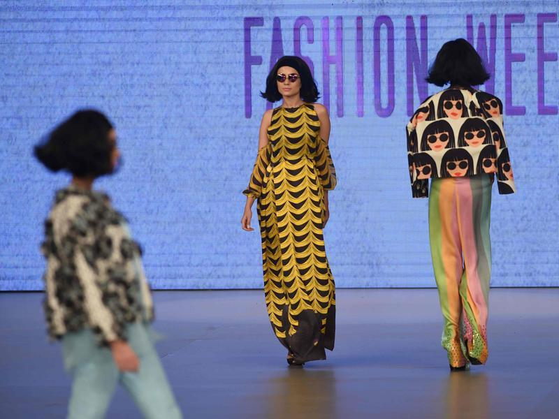 Feeha used the motif of a dark-haired girl with round sunglasses in her designs and even made her mode carry the same look. (AFP)
