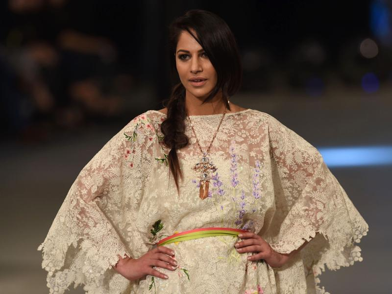 A model presents a creation by Pakistani designer Sana Safinaz. The lace is so overpowering. (AFP)