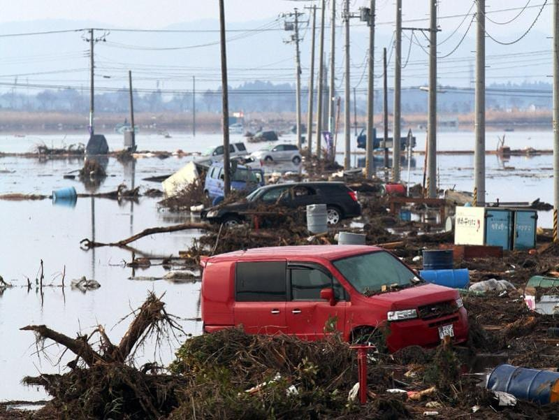 This March 12, 2011 photo shows cars and debris littering an area of Sendai city after a monster tsunami unleashed by a massive quake wreaked destruction across northeast Japan. (AFP File Photo)