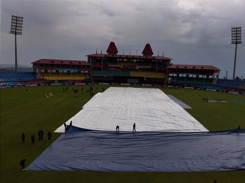 Groundsmen cover pitch due to rains during the T20 World Cup match. (PTI Photo)