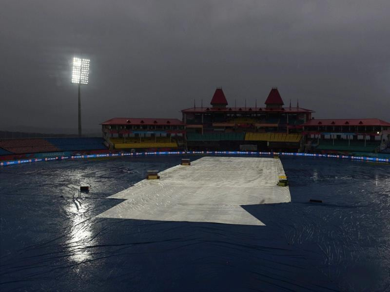 The ground is covered as it rains during the T20 World Cup match between Oman and Netherlands in Dharamshala. (PTI Photo)